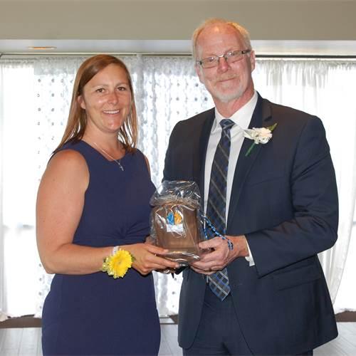 Award recipient from the Father Kyran Kennedy Catholic Education Centre Charlene Doyle with Director of Education David Hansen